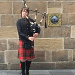 Young Busker Playing Bagpipes